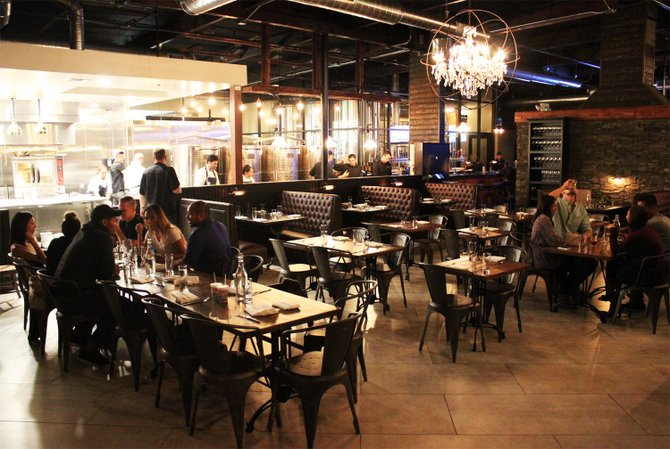 An open kitchen awaits guests at The Cork and Craft  - Image by @sdbeernews