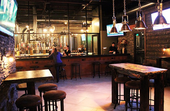 The tasting room at The Cork and Craft offers Abnormal Wine Company vino and a view of the upcoming Abnormal Beer Company brewhouse