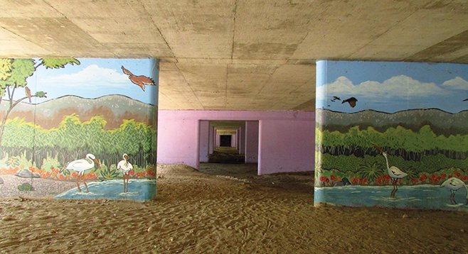 Murals located along the trail going under the roadway
