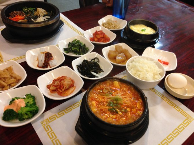 Banchan in the white dishes, left to right: eomuk, cheongpomuk, sigeumchi, ggakdugi, kongnamul, broccoli, kimchi, miyeok, gamja jorim, cheonsachae. Do Re Mi House.