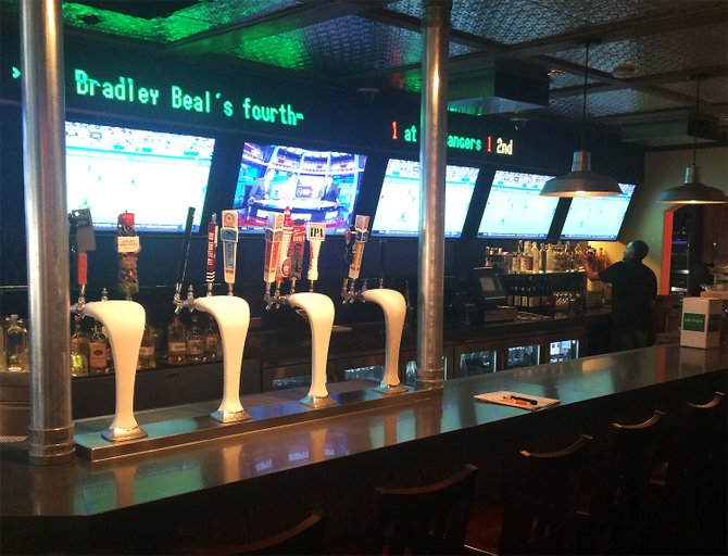 The remodeled bar at Phil's BBQ's San Marcos location includes a 50-foot sports ticker