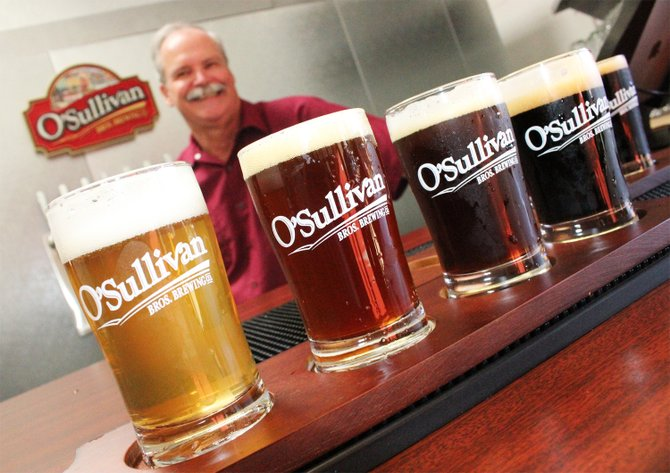 O'Sullivan Bros. Brewing Company owner Ed O'Sullivan serves up tasters of his Scripps Ranch brewery's beers - Image by @sdbeernews