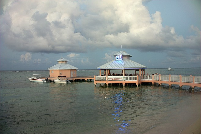 "Mimi's Dock Bar at Morritt's on Grand Cayman, the ""only dock bar in the Cayman Islands."""