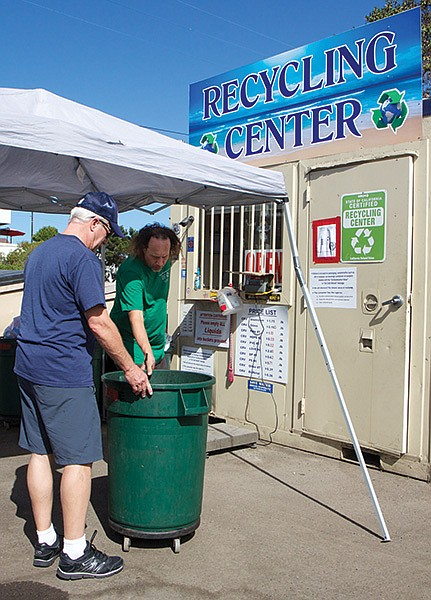 The four-month-old recycling center in the Stump's parking lot is mandated by state law to be there.