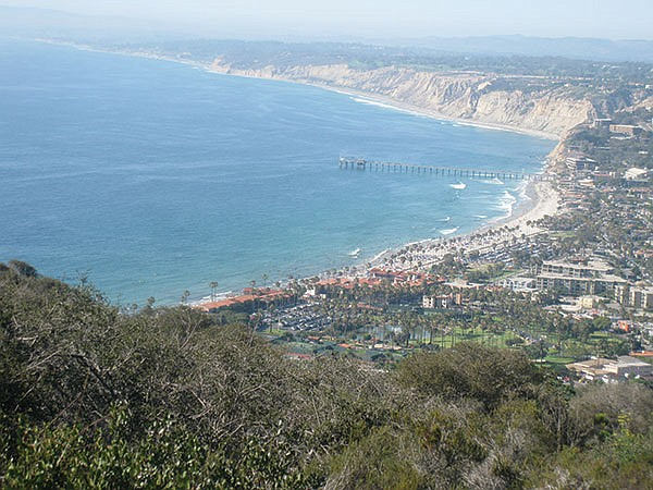 The view is a sweeping panorama of the La Jolla shoreline.