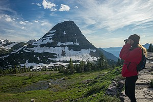 My girlfriend Rosalie keeps an eye out for grizzlies along Logan's Pass in Glacier National ...