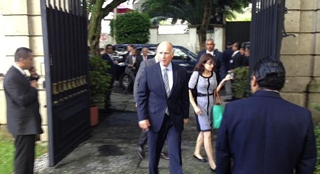 Governor Jerry Brown, walking through the gates to enter Casa de California in Mexico City