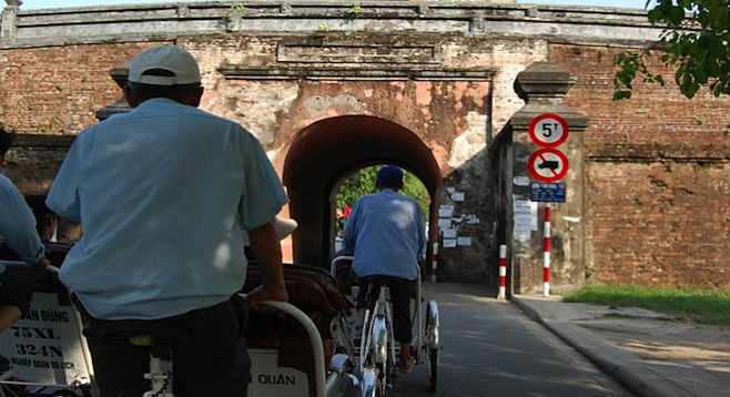 Riding to Huế's historic Citadel in a fleet of cyclos, the Vietnamese rickshaw-meets-bicycle.