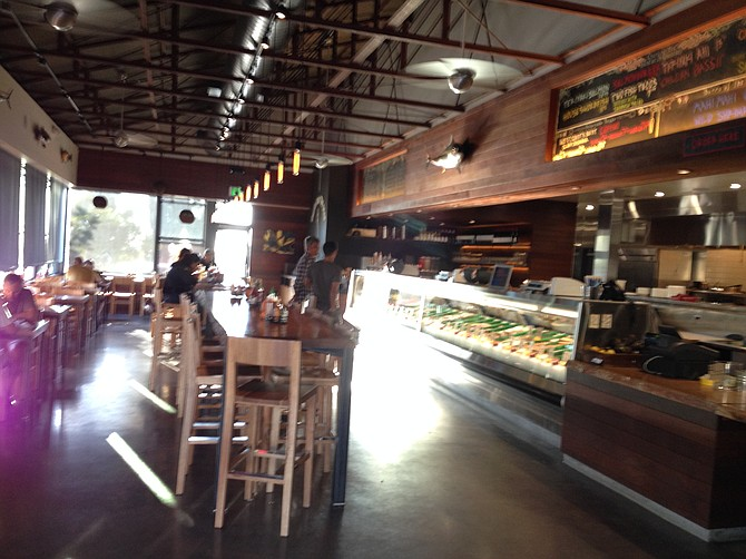 Inside matches the look of many a new breed SD restaurant, with high ceilings and community seating.
