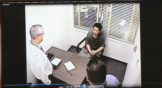 Detectives interviewing Bryan Chang