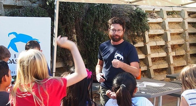 Coastkeeper's Travis Pritchard fields questions from young students