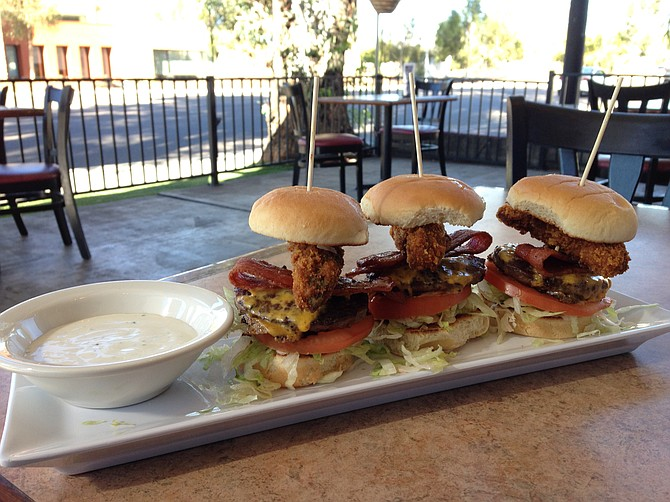 Fried Avocado Cheeseburger Sliders served with a bowl of ranch. Oh boy. Up the Hill Grill.
