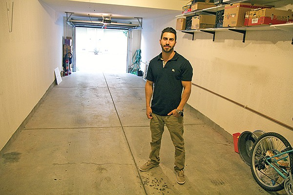 John Forouzandeh's two-car garage can't accommodate his three-car household.