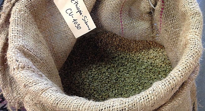 A sack of green coffee beans at Café Virtuoso