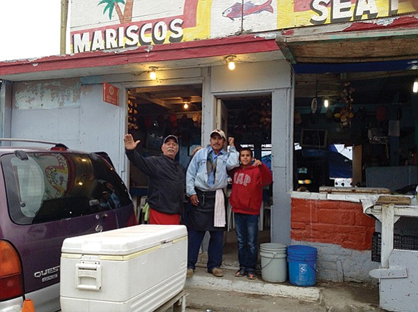 Jorge Ruiz, his son Paul, and grandson Gerardo wave goodbye