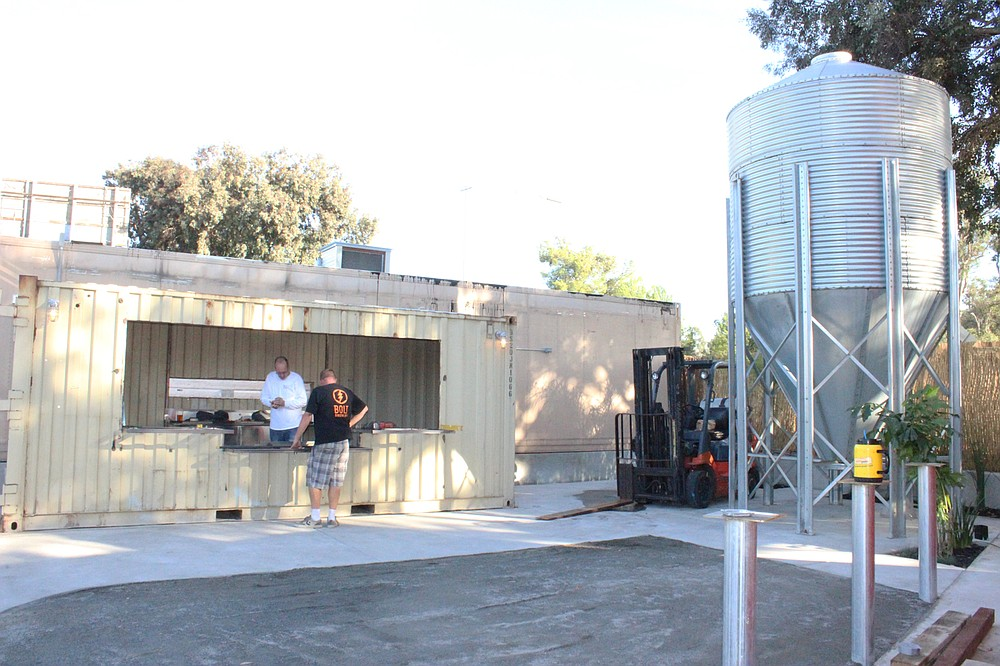 The tasting bar in the lower portion of the beer garden at Bolt Brewery