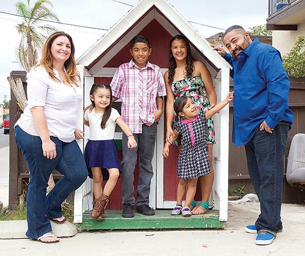 Juan Carlos Pastenes (right) and family
