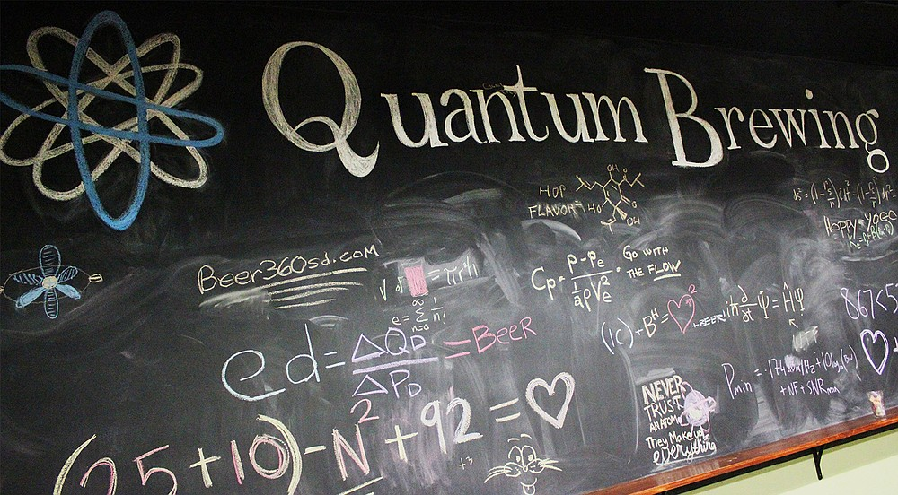 Two beer writers' fondness for each other conveyed via an equation on Quantum Brewery's chalkboard wall