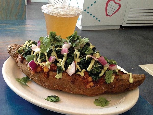 Stuffed baked sweet potato. Looks like a swimming pig, but zero animal products are allowed into this establishment.