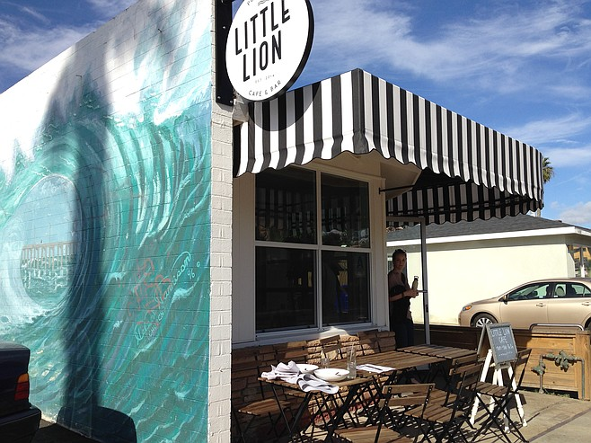 The wave mural remains, though the restaurant here has changed for the better.