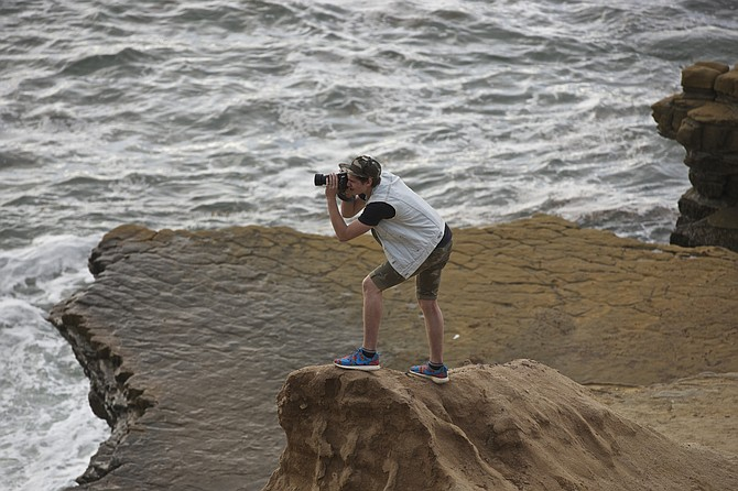 The daring photographer. Point Loma light house