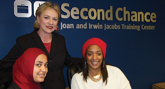 Trisha Gooch (center) with her colleagues at Second Chance