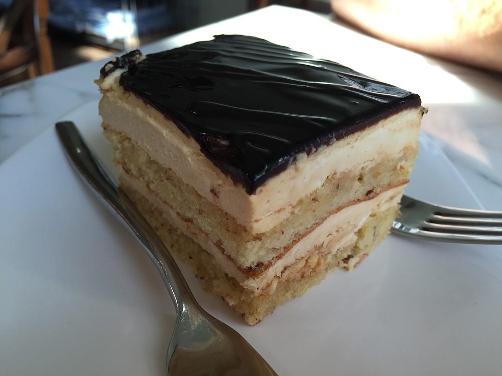 Almond cake with caramel cream and chocolate ganache