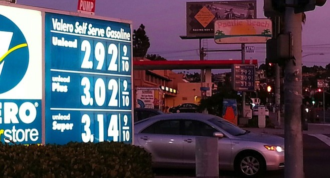 Dueling gas stations at the corner of Ingraham and Grand battle daily for lowest price.