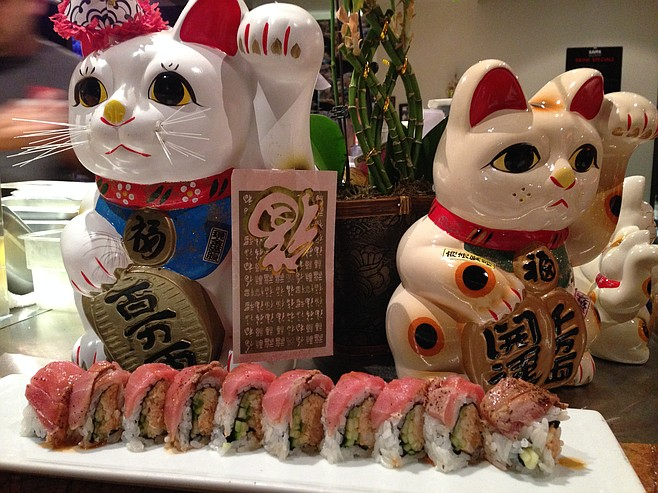 Couple of cat figurines and the El Diablo roll. Kappa Sushi.
