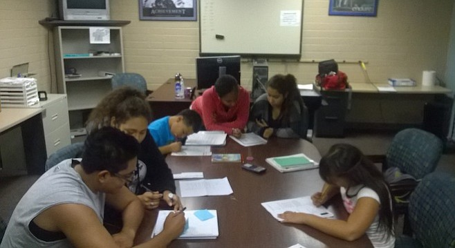 Kids doing homework together at Community Youth Athletic Center, which nearly got shut down by National City in that eminent domain dispute.
