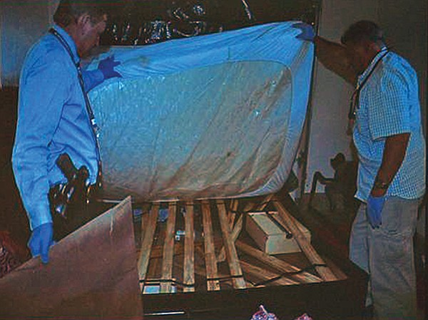 Police lifted a mattress and found a body hidden underneath.