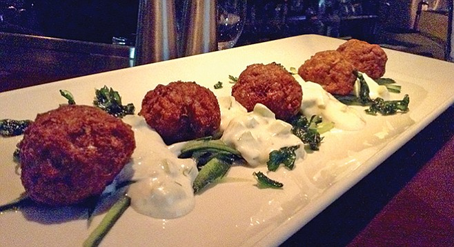 Lamb meatballs with tzatziki sauce, at $6.99, tops the happy-hour value menu.