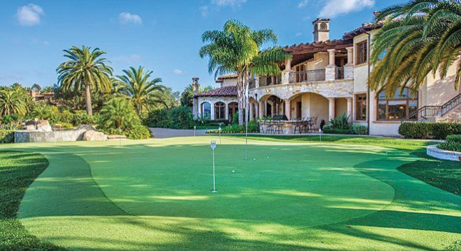 The backyard boasts a lagoon-style pool and 63-yard par-three hole of golf.