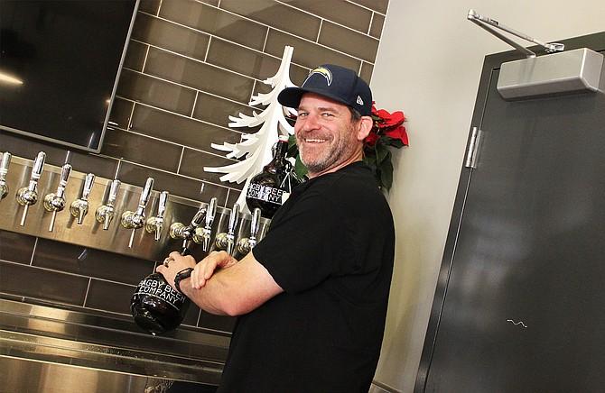 Bagby Beer Company owner and brewmaster Jeff Bagby filling growlers at his Oceanside brewpub - Image by @sdbeernews