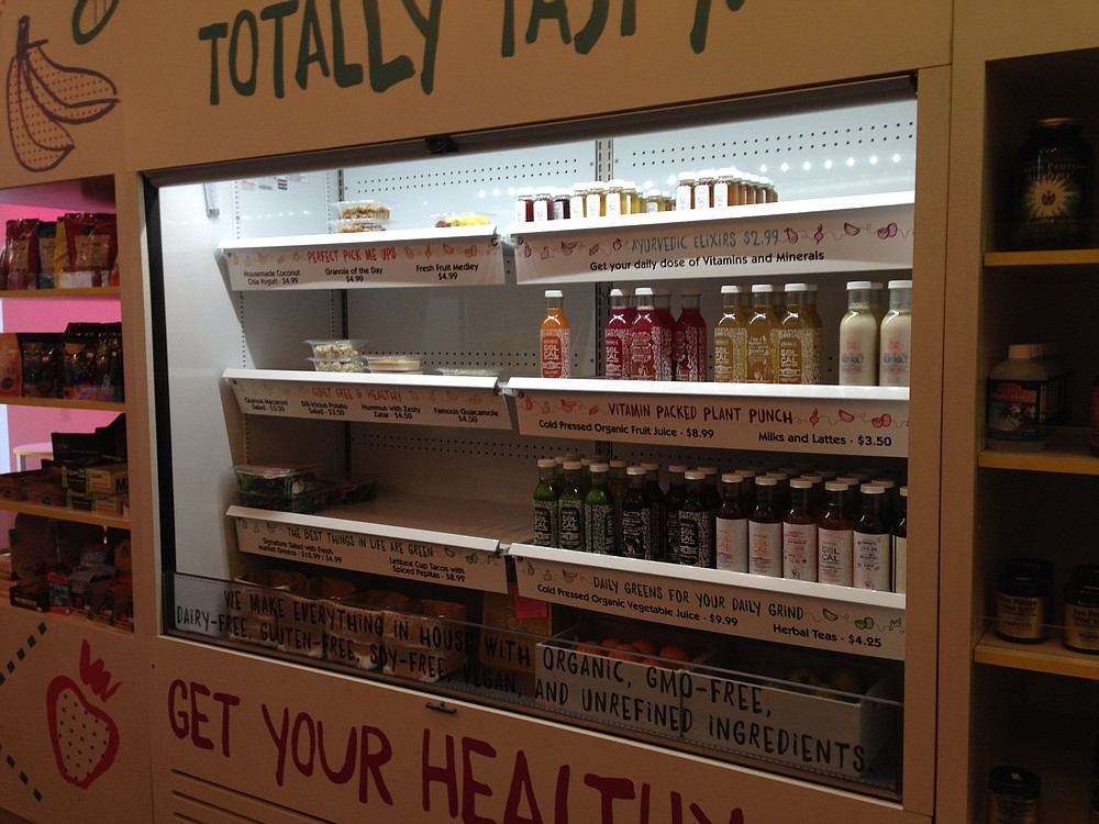 Cold press juice and packaged meals on market shelves. Sol Cal.