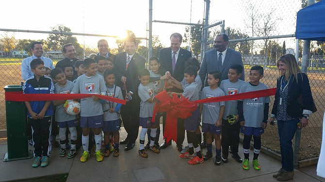 City officials and San Ysidro soccer players cut the ribbon to the newly illuminated Larsen Field.