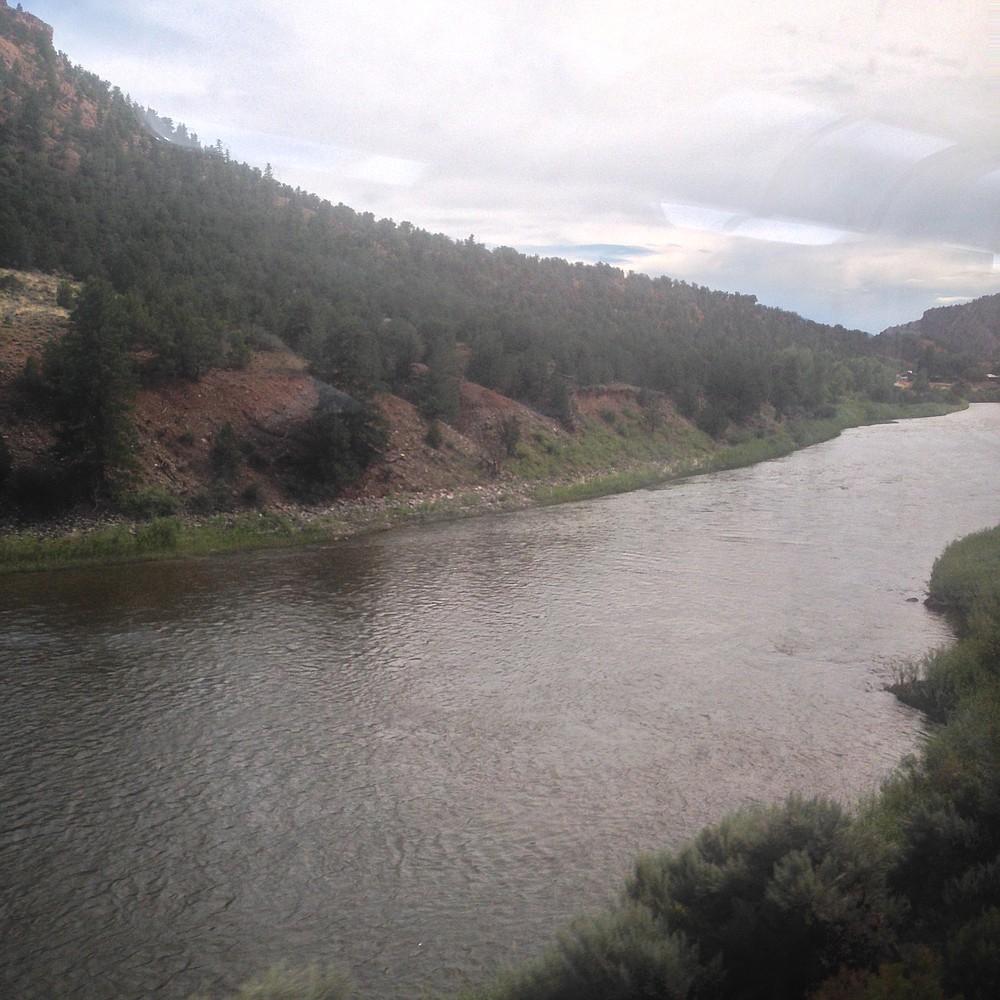 Train window view of the Colorado River.