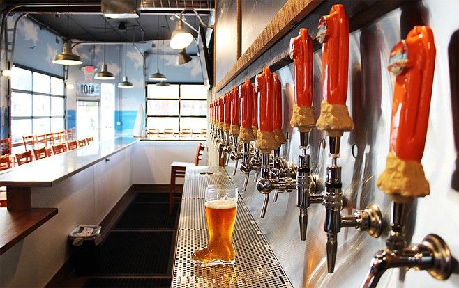 A boot holding beer for a ceremonial pre-opening toast awaits the owners and staff at Rip Current Brewing North Park