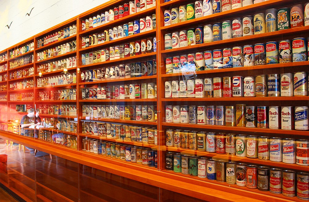 The vintage beer can wall at Rip Current Brewing North Park