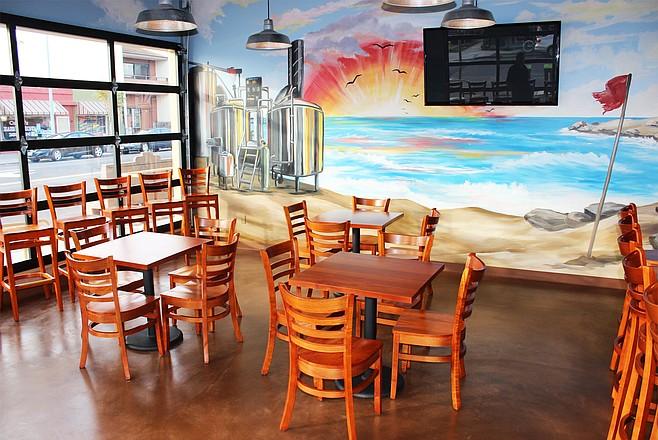 Rip Current's coastal motif is conveyed via a mural running across three walls of its North Park tasting room