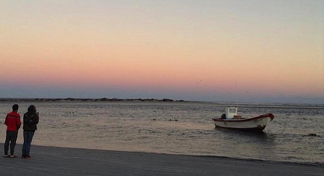 Admiring the sunset in Estero La Bocana.