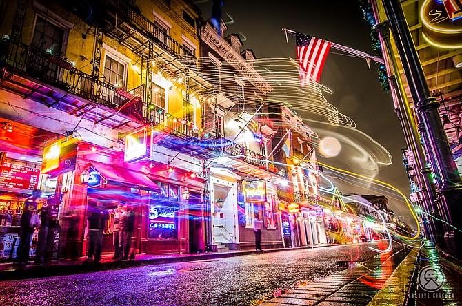 Travel Photo Contest-   Light Trails on Bourbon St. |  New Orleans, LA  www.cre8ivekitchen.com Artist: Ben Rivera cre8ivekitchen@gmail.com