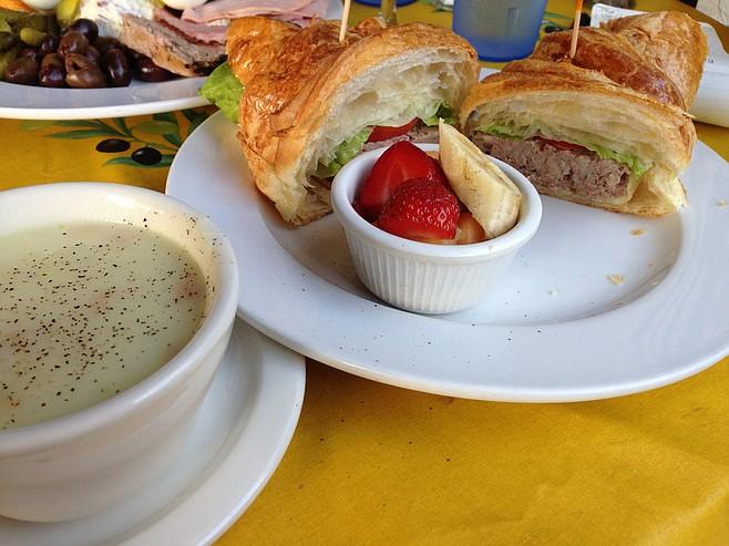 A big croissant handles a thick chunk of pâté. Pâté Sandwich. A Delight of France.