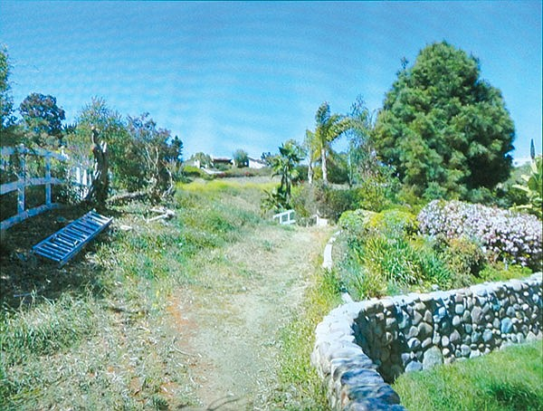 Evidence photo of the stone wall, which encroached 17 feet onto Vilkin's land