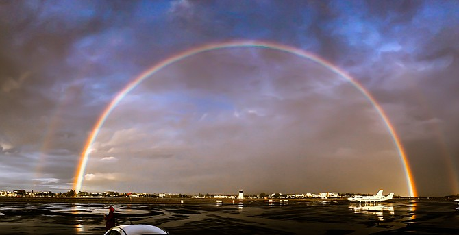 This photo was taken on December 16th, 2014, after a much needed rain storm at Montgomery Field in Kearny Mesa.  The photo is shot looking northeast towards Montgomery tower from the airport transient ramp.  I was kicking myself for not having my good camera with me and unfortunately I had to snap the photo with an iPhone.  The sight was just too beautiful to not capture it somehow.