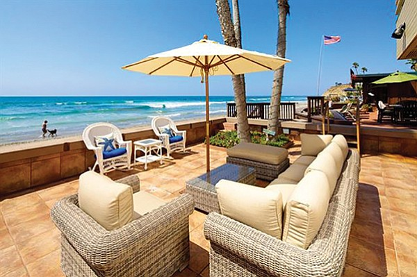 Patio sits above the sand, natch