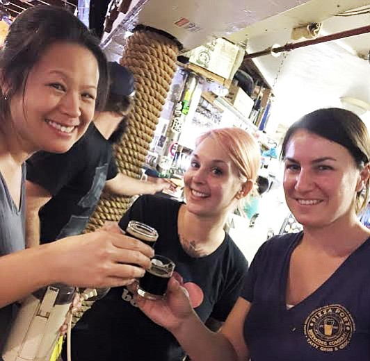 Eagle Rock's Ting Su (left), Keep A Breast Foundation's Melanie Pierce (center), and Pizza Port's Devon Randall unwind after a busy collaboration brew day.