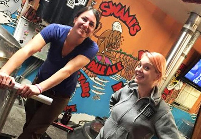 Devon Randall (left) and Melanie Pierce brewing up their contribution to the 2015 Brewbies Festival at Pizza Port Solana Beach.
