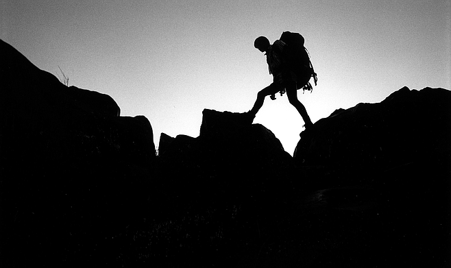"""It was a sharp descent off the ridge, over rotten scree, but Schad soon found a sheep trail to the bottom. As he bounded down the canyon side, he shouted back to me Schad's Rule of Thumb: """"I figure I can go anywhere a sheep can go!"""""""