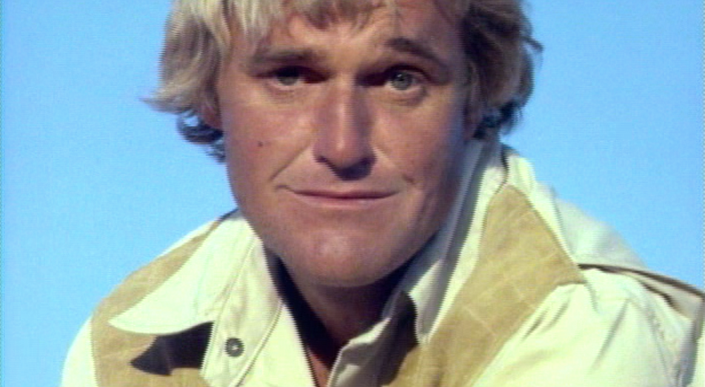 Charles Napier's curtain shot in Russ Meyer's Supervixens